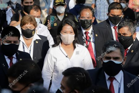Keiko Fujimori, daughter of imprisoned ex-President Alberto Fujimori and presidential candidate for the Popular Force party, arrives to vote during general elections in Lima, Peru, . Peruvians went to the polls amid a surge in new COVID-19 infections