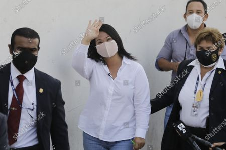 Keiko Fujimori, daughter of imprisoned ex-President Alberto Fujimori and presidential candidate for the Popular Force party, waves as she arrives to vote during general elections in Lima, Peru, . Peruvians went to the polls amid a surge in new COVID-19 infections