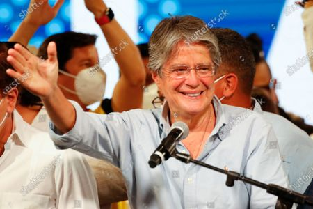 Guillermo Lasso, presidential candidate of Creating Opportunities party, CREO, speaks to supporters after a presidential runoff election at his campaign headquarters in Guayaquil, Ecuador, . With most of the votes counted Lasso, a former banker, had a lead over economist Andres Arauz, a protege of former President Rafael Correa