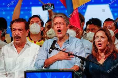Guillermo Lasso, presidential candidate of Creating Opportunities party, CREO, center, celebrates with his wife María de Lourdes Alcívar, right, after a presidential runoff election at his campaign headquarters in Guayaquil, Ecuador, . With most of the votes counted Lasso, a former banker, had a lead over economist Andres Arauz, a protege of former President Rafael Correa