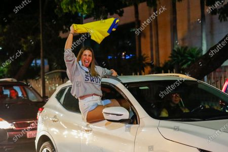 Supporter of Guillermo Lasso, candidate of Creating Opportunities party or CREO, celebrates in Guayaquil, Ecuador, . Lasso, a former banker, won a runoff presidential election beating economist Andres Arauz, a protege of former President Rafael Correa