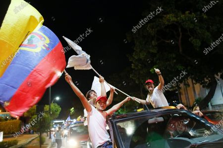 Supporters of Guillermo Lasso, candidate of Creating Opportunities party or CREO, celebrate in Guayaquil, Ecuador, . Lasso, a former banker, won a runoff presidential election beating economist Andres Arauz, an economist protege of former President Rafael Correa