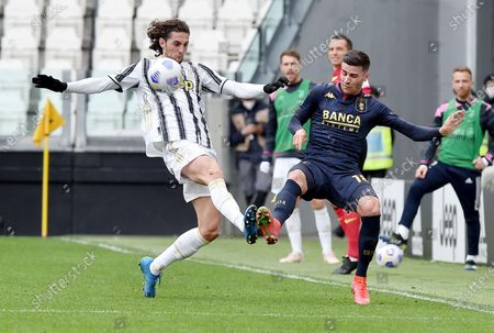 Juventus' Adrien Rabiot (L) and Genoa's Paolo Ghiglione in action during the Italian Serie A soccer match Juventus FC vs Genoa CFC at the Allianz Stadium in Turin, Italy, 11 April 2021.