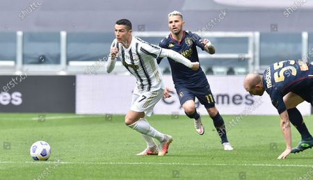 Stock Image of Juventus' Cristiano Ronaldo (L) and Genoa's Valon Behrami (C) in action during the Italian Serie A soccer match Juventus FC vs Genoa CFC at the Allianz Stadium in Turin, Italy, 11 April 2021.