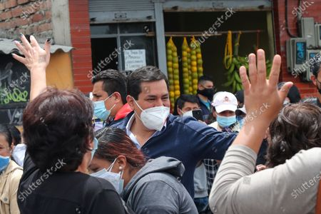 Andres Arauz, presidential candidate of the Alianza Union por la Esperanza, UNES, greets supporters as he arrives to a polling post to accompany a supporter to vote during a runoff presidential election in Quito, Ecuador, . Ecuadorians are voting to choose between Arauz, an economist protégé of former President Rafael Correa, and former banker Guillermo Lasso, of Creating Opportunities party, or CREO