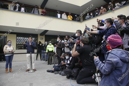 Andres Arauz, presidential candidate of the Alianza Union por la Esperanza, UNES, speaks at the polling post where he accompanied a supporter to vote in a runoff presidential election in Quito, Ecuador, . Ecuadorians are voting to choose between Arauz, an economist protégé of former President Rafael Correa, and former banker Guillermo Lasso, of Creating Opportunities party, or CREO