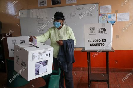 Man votes during a runoff presidential election in Quito, Ecuador, . Amid the new coronavirus pandemic Ecuadorians are voting to choose between Andres Arauz, from the Union of Hope coalition, an economist protégé of former President Rafael Correa, and former banker Guillermo Lasso, of Creating Opportunities party, or CREO