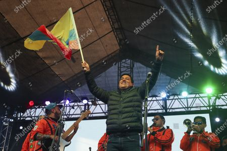 Andres Arauz, presidential candidate of the Alianza Union por la Esperanza, UNES, party waves to supporters gathered at his campaign headquarters in Quito, Ecuador, after the closing of the polls for a runoff presidential election . Ecuadorians voted to choose between Arauz, an economist protégé of former President Rafael Correa, and former banker Guillermo Lasso, of Creating Opportunities party, or CREO