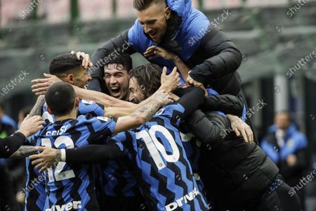 Inter Milan's Matteo Darmian, right, celebrates with teammates Alessandro Bastoni, Lautaro Martinez, Stefano Sensi and Achraf Hakimi, left, after scoring during a Serie A soccer match between Inter Milan and Cagliari at the San Siro stadium in Milan, Italy