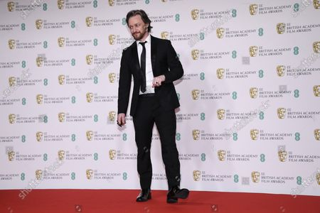 Actor James McAvoy poses for photographers upon arrival at the Bafta Film Awards, in central London
