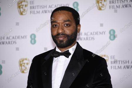 Actor Chiwetel Ejiofor poses for photographers upon arrival at the Bafta Film Awards, in central London