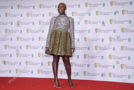 Actress Cynthia Erivo poses for photographers upon arrival at the Bafta Film Awards, in central London