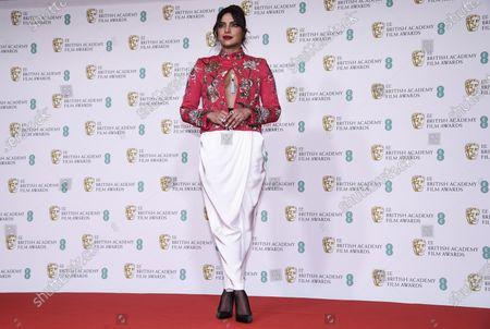 Actress Priyanka Chopra Jonas poses for photographers upon arrival at the Bafta Film Awards, in central London