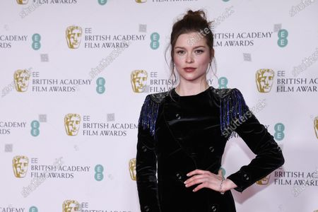 Actress Sophie Cookson poses for photographers upon arrival at the Bafta Film Awards, in central London