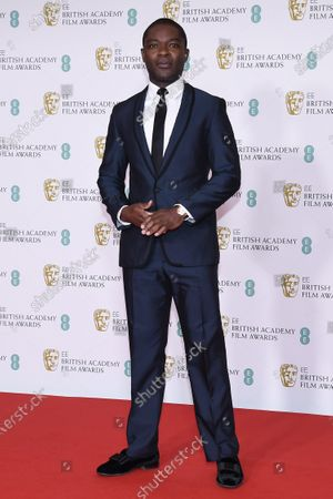 Stock Photo of Actor David Oyelowo poses for photographers upon arrival at the Bafta Film Awards, in central London