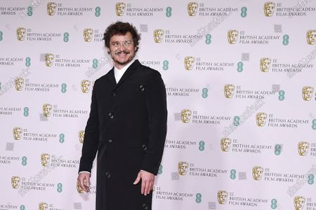 Actor Pedro Pascal poses for photographers upon arrival at the Bafta Film Awards, in central London