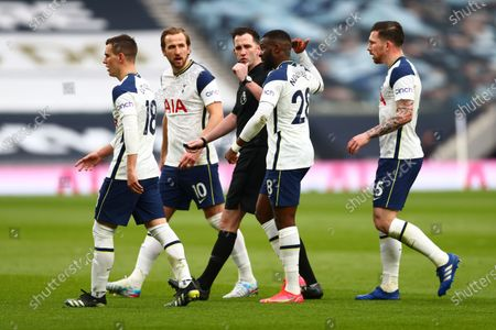 Referee Chris Kavanagh (C) argues with players of Tottenham during the English Premier League match between Tottenham Hotspur and Manchester United in London, Britain, 11 April 2021.