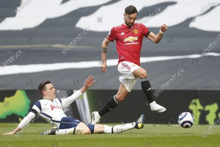 Tottenham's Giovani Lo Celso (L) in action against Manchester United's Bruno Fernandes (R) during the English Premier League match between Tottenham Hotspur and Manchester United in London, Britain, 11 April 2021.