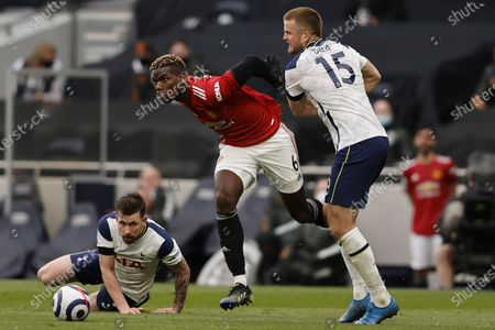 Manchester United's Paul Pogba (C) in action against Tottenham's Eric Dier (R) during the English Premier League match between Tottenham Hotspur and Manchester United in London, Britain, 11 April 2021.