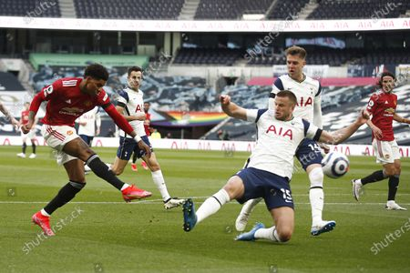 Manchester United's Marcus Rashford (L) in action against Tottenham's Eric Dier (R) during the English Premier League match between Tottenham Hotspur and Manchester United in London, Britain, 11 April 2021.