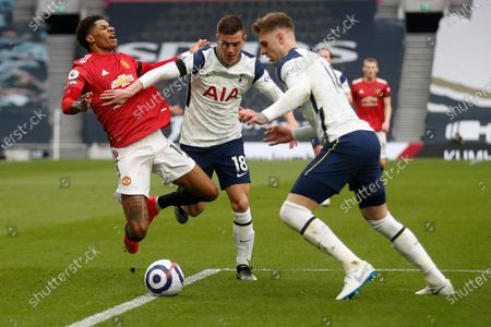 Manchester United's Marcus Rashford, left, is faulted by Tottenham's Giovani Lo Celso during the English Premier League soccer match between Tottenham Hotspur and Manchester United at the Tottenham Hotspur Stadium in London