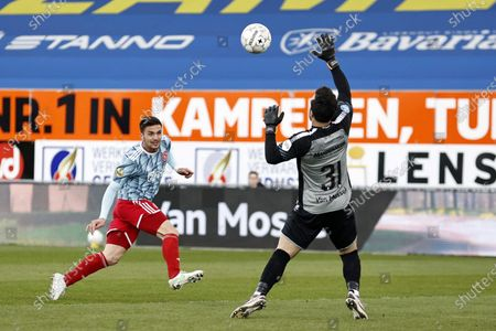 (L-R) Dusan Tadic of Ajax, RKC Waalwijk goalkeeper Kostas Lamprou during the Dutch Eredivisie match between RKC Waalwijk and Ajax at the Mandemakers Stadium in Waalwijk, The Netherlands, 11 April 2021.