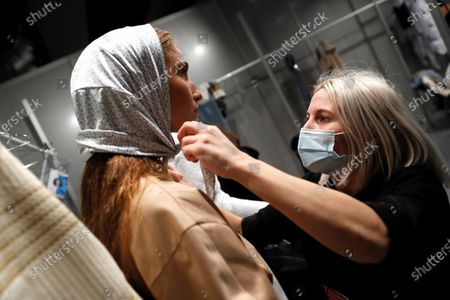 Spanish fashion designer Georgina Jose Garcia (R) prepares a model backstage to present creations from the Fall-Winter 2021/2022 collection of the Georgiela Studio fashion brand during a young talents 'EGO' fashion show on the last day of the 73rd Mercedes-Benz Fashion Week Madrid, in Madrid, Spain, 11 April 2021. The fashion event runs from 08 to 11 April.