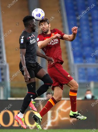 Bologna's Musa Barrow, left, and Roma's Federico Fazio challenge for the ball during the Italian Serie A soccer match between Roma and Bologna at Rome's Olympic stadium, Italy