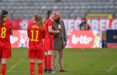 Stock Photo of Belgium's Tine De Caigny receives the Golden Boot -Gouden Schoen - Soulier d'Or from Red Devils head coach Roberto Martinez ahead of a friendly women's soccer game between Belgium's national team the Red Flames and the Republic of Ireland, Sunday 11 April 2021 in Brussels.