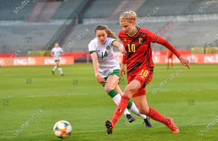 Irish Heather Payne and Belgium's Justine Vanhaevermaet fight for the ball during a friendly women's soccer game between Belgium's national team the Red Flames and the Republic of Ireland, Sunday 11 April 2021 in Brussels.