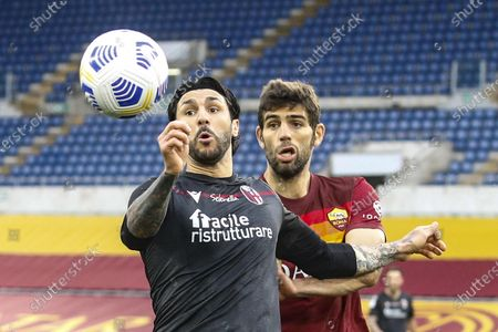 Bologna's Roberto Soriano (L) and Roma's Federico Fazio in action during the Italian Serie A soccer match between AS Roma and Bologna FC at the Olimpico stadium in Rome, Italy, 11 April 2021.