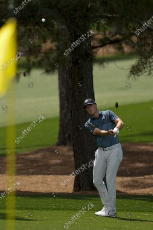 Jordan Spieth hits to the second green during the final round of the Masters golf tournament, in Augusta, Ga