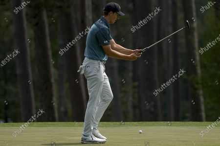 Jordan Spieth reacts to a missed putt on the third hole during the final round of the Masters golf tournament, in Augusta, Ga