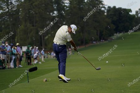 Hideki Matsuyama, of Japan, tees off on the eighth hole during the final round of the Masters golf tournament, in Augusta, Ga