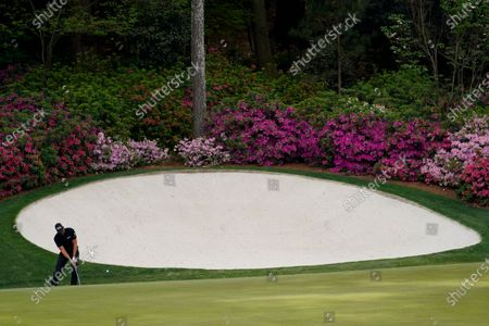 Henrik Stenson, of Sweden, chips to the 13th green during the final round of the Masters golf tournament, in Augusta, Ga