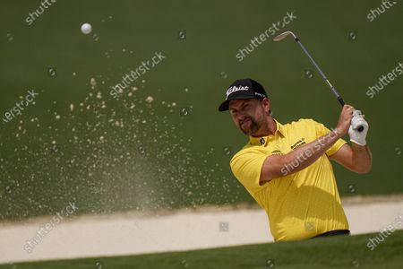 Webb Simpson hits out of a bunker on the second hole during the final round of the Masters golf tournament, in Augusta, Ga