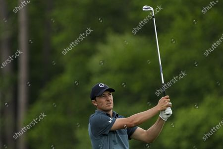 Jordan Spieth watches his tee shot on the 12th hole during the final round of the Masters golf tournament, in Augusta, Ga