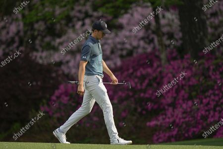 Jordan Spieth walks to the 13th green during the final round of the Masters golf tournament, in Augusta, Ga