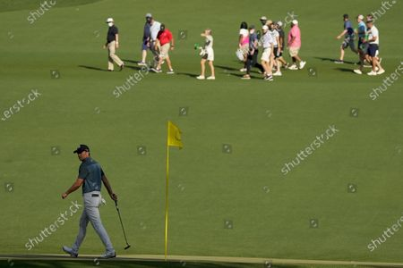 Jordan Spieth walks off the 15th green during the final round of the Masters golf tournament, in Augusta, Ga