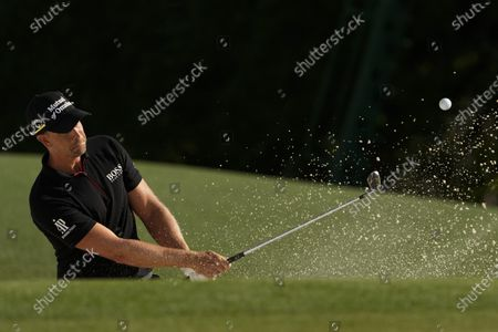 Henrik Stenson, of Sweden, hits from the bunker to the 18th green during the final round of the Masters golf tournament, in Augusta, Ga