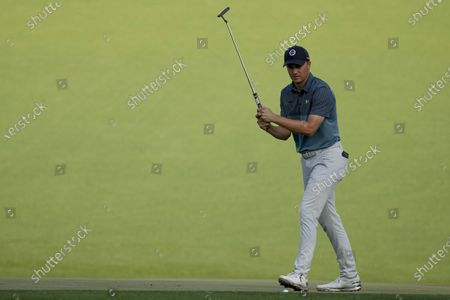 Jordan Spieth reacts to a missed birdie putt on the 15th green during the final round of the Masters golf tournament, in Augusta, Ga