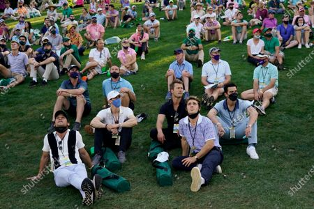 Spectators watch Jordan Spieth's ball after his tee shot on the 15th hole during the final round of the Masters golf tournament, in Augusta, Ga