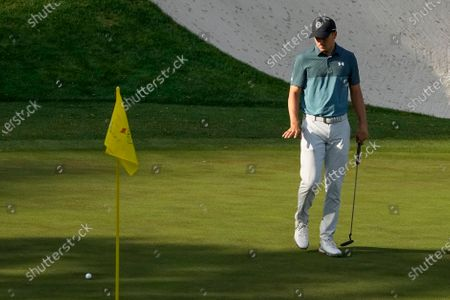 Jordan Spieth watches his putt on the 16th green during the final round of the Masters golf tournament, in Augusta, Ga