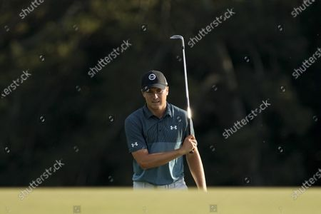 Jordan Spieth walks up to the 18th green during the final round of the Masters golf tournament, in Augusta, Ga