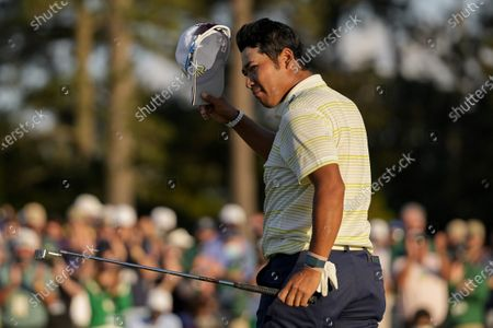 Hideki Matsuyama, of Japan, tips his cap after winning the Masters golf tournament, in Augusta, Ga