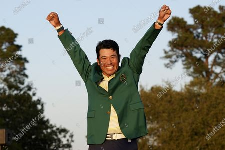 Hideki Matsuyama, of Japan, celebrates after putting on the champion's green jacket after winning the Masters golf tournament, in Augusta, Ga