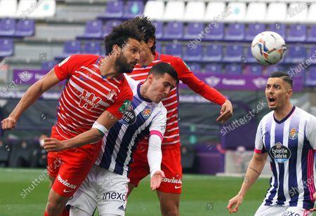Granada's Jose Antonio Puertas (L) in action during the Spanish LaLiga soccer match between Real Valladolid and Granada at Jose Zorilla stadium in Valladolid, Spain, 11 April 2021.