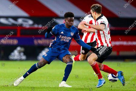Bukayo Saka of Arsenal takes on Ethan Ampadu of Sheffield United