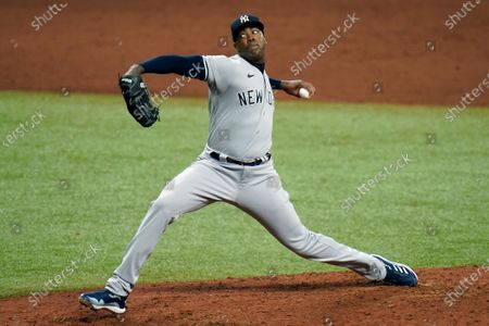 New York Yankees relief pitcher Aroldis Chapman delivers to the Tampa Bay Rays during the ninth inning of a baseball game, in St. Petersburg, Fla