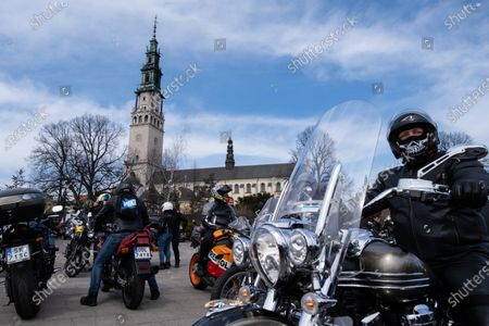 Motorcyclists seen on their bikes in front of Jasna Gora Monastery. Every year in the spring thousands of motorcyclists come to Jasna Gora Monastery in Czestochowa for blessing of motorcycles. It is known as the official opening of motorcycle season in Poland. Jasna Gora with the image of the Black Madonna is the biggest sanctuary in Poland for all Catholics.